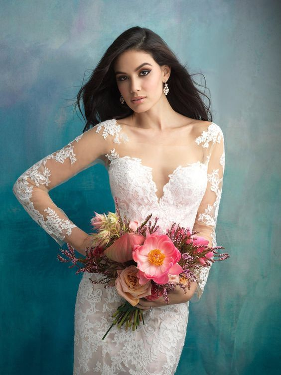 Vintage-inspired lace appliques adorn this chic look featuring long sleeves and a flattering sweetheart neckline. Allure Bridal gowns, bridesmaid dresses, and accessories will all be 20% off at TERRY COSTA!