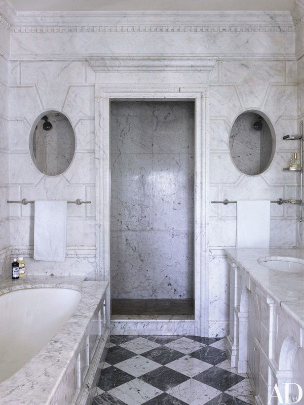 In the master bath, trompe l'oeil–painted walls join a floor set with blocks of Carrara and Bardiglio marble | archdigest.com