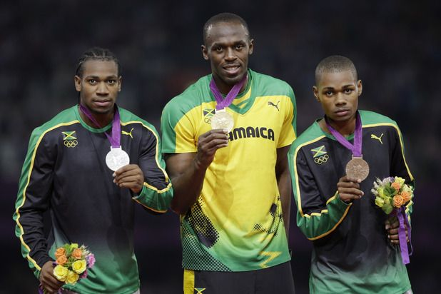 Jamaica's gold medal winner Usain Bolt is flanked by his teammates silver medal winner Yohan Blake, left, and bronze medalist Warren Weir for the men's 200-meters.  Amazing athletes!