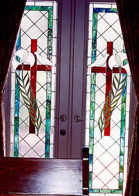 Pair of stained glass Lily & Dove door panels for private chapel in West Palm Beach. Original design by Kelly Haggard Olson. All Rights Reserved.