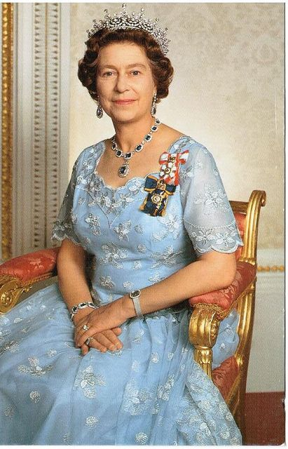 Queen Elizabeth II wearing The Order of Canada insignia. This photo is often seen in Canada as official memento gifts from the Royal Visit.