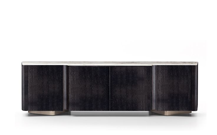 LOU | BOOKCASES – SIDEBOARDS - EN The sinuous shapes that set the Lou collection apart are revisited in the design of the horizontal sideboard, designed as the perfect companion to the table.