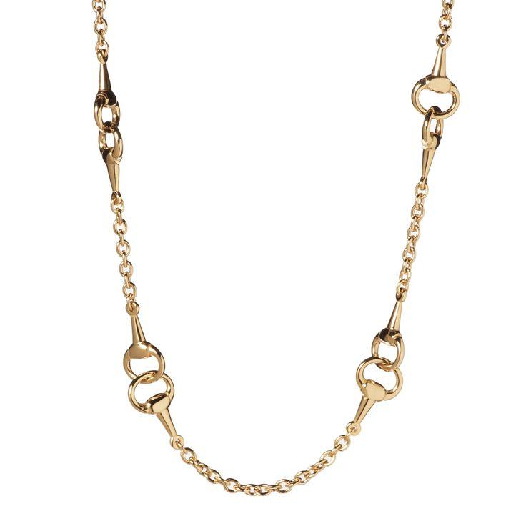 Bronzallure, collana in bronzo placcato oro rosa con una maglia rolò ad anelli ovali in cui si inseriscono quattro elementi a morso di cavallo intrecciati.