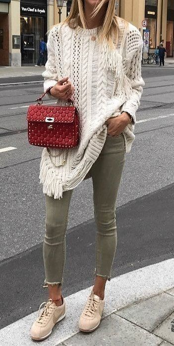 #fall #outfits women's white knitted sweater with red leather hand bag, gray denim jeans, and beige Nike sneakers