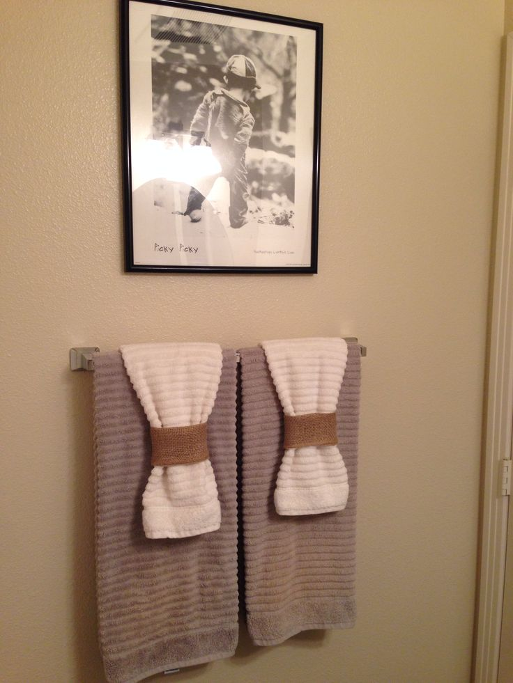 Bathroom towels - nice way of adding detail on the towel without having a bow.