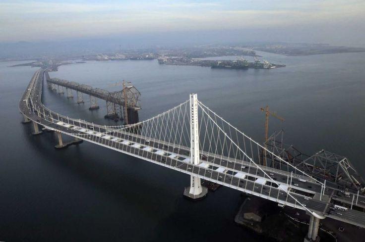 Demolition of the old road bridge between Oakland and Tresure Island - aerial view