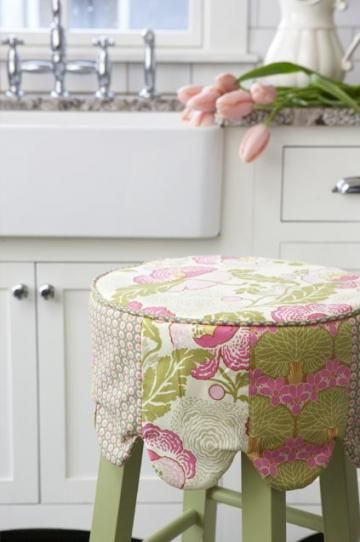 adorable barstool cover turns a plain, inexpensive chair into a custom piece of furniture that picks up prints and colors from throughout the room.You can change the look of the room by just swapping out covers!