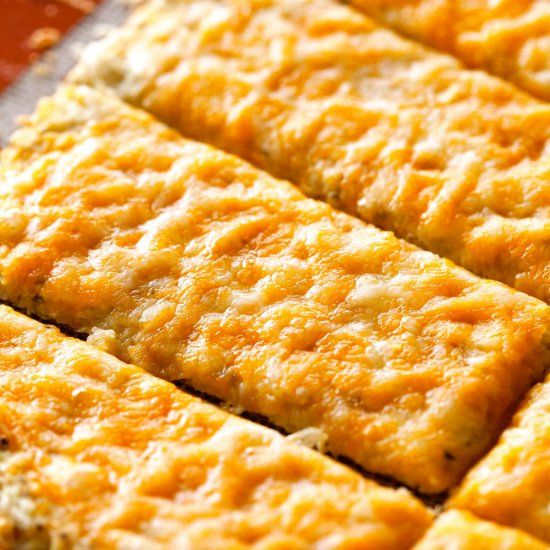 Low-carb breadsticks made with a cauliflower crust that tastes just like the real deal. Plus, they are super easy to make!