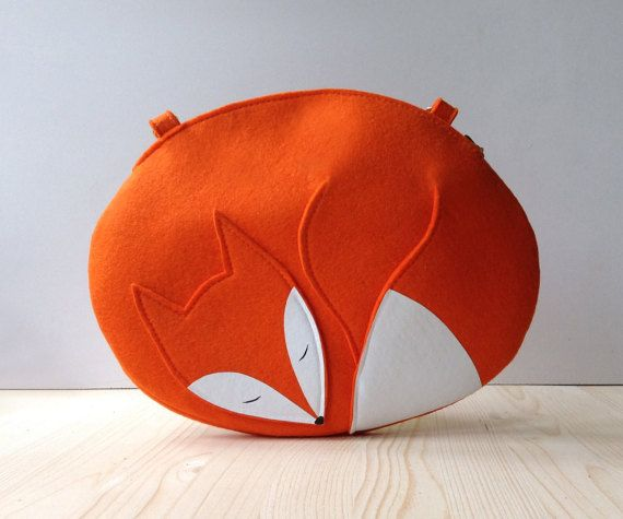 This bag is made in a shape of a sleeping fox. Made of orange natural felt and white and black print.  = Dimensions = 7,5 H 9,8 W  It has an