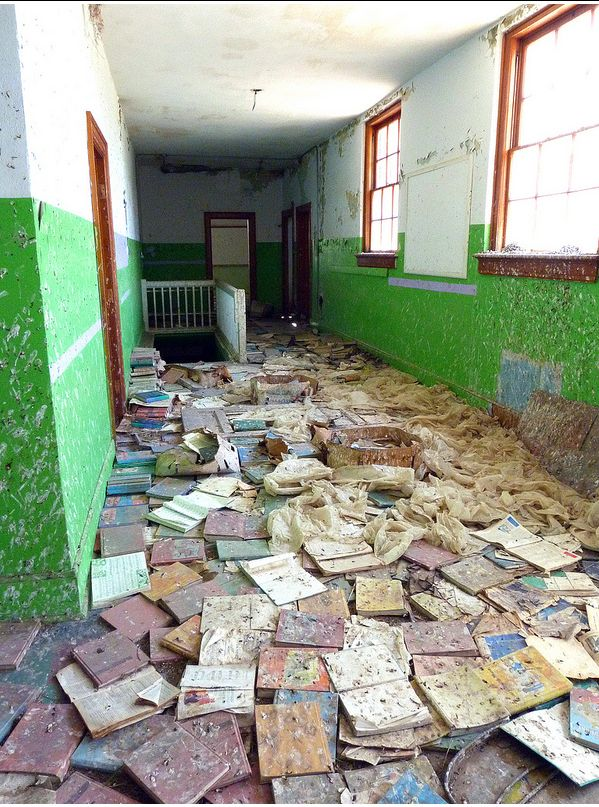 Why are these books lining the floor in this #abandoned hallway? Huntley, Wyoming