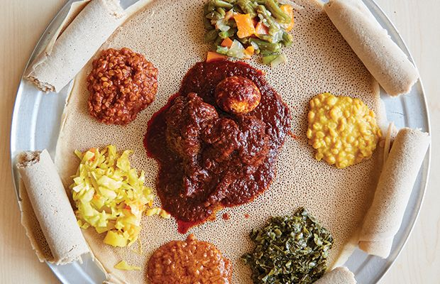 """Next door to a 7-Eleven on Camp Bowie is the modest storefront for Samson's Market Bistro, Fort Worth's first East African deli, serving up traditional and unforgettable Ethiopian meals in Arlington Heights. """"Have you ever eaten Ethiopian food?"""" owner Samson Yosef asks, moving our water glasses aside to make room for an oversized platter."""