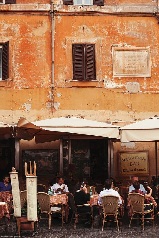 I ate outside a restaurant in an alley way like this in Spring time  November in Rome, Italy