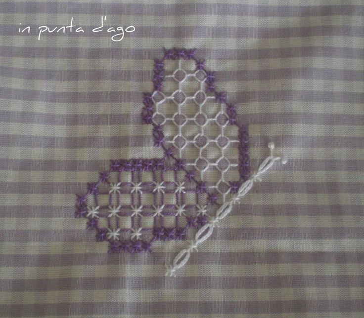 in punta d'ago: broderie suisse Butterfly on gingham Chicken scratch
