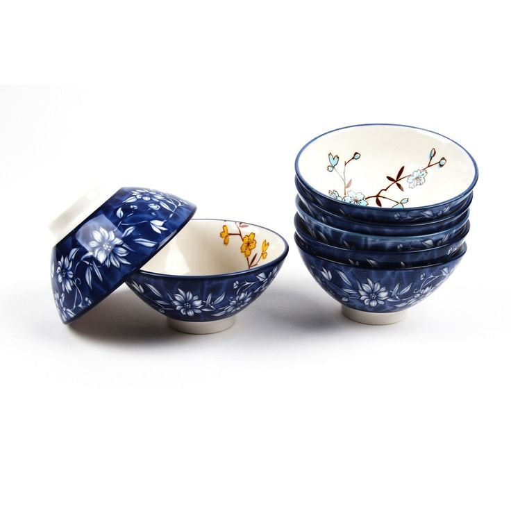 Oriental style Rice and soup bowls set! Interested in decorating your dinner table in an exotic way? Elegance, graceful, classical beauty and modernistic beauty. Combination of gorgeous and vivid color. Virginity of the White and Blue porcelain. It comes with 7 pieces of bowls and Floral covered.