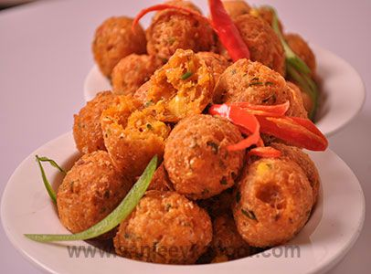 Corn Cheese Balls - Corn and cheese mixed with Schezwan chutney, shaped into balls and deep fried.