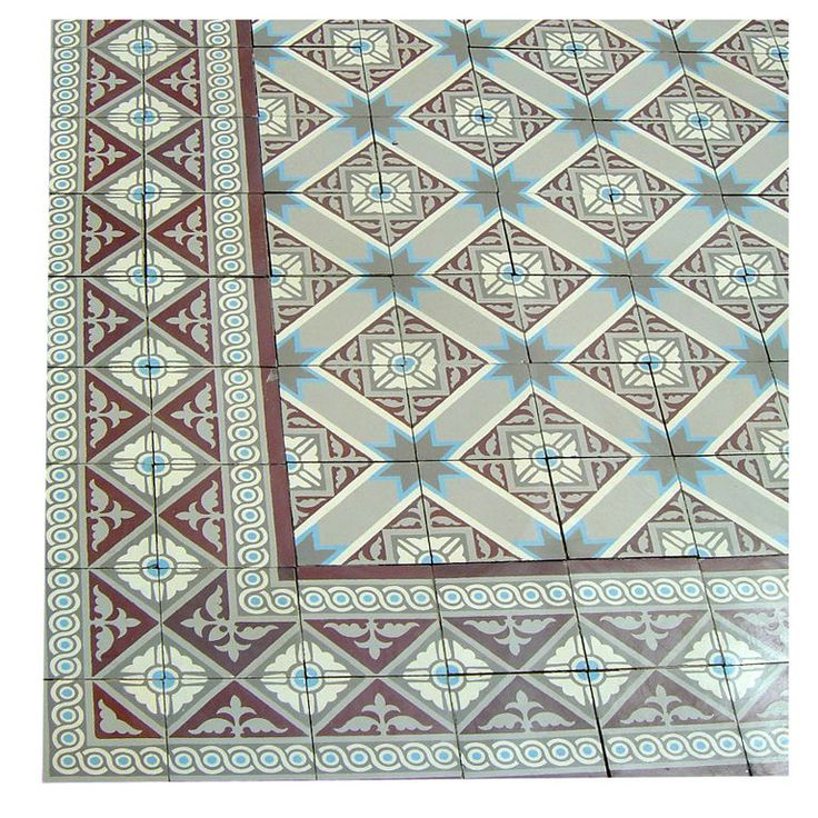 A small and complete ceramic encaustic entranceway floor, totaling 75 sq ft, dated 1920. The floor consists of a principal field tile in off white and grey with a starred blue motif, complimented by an ornate double back to back border tile in predominantly aubergine.