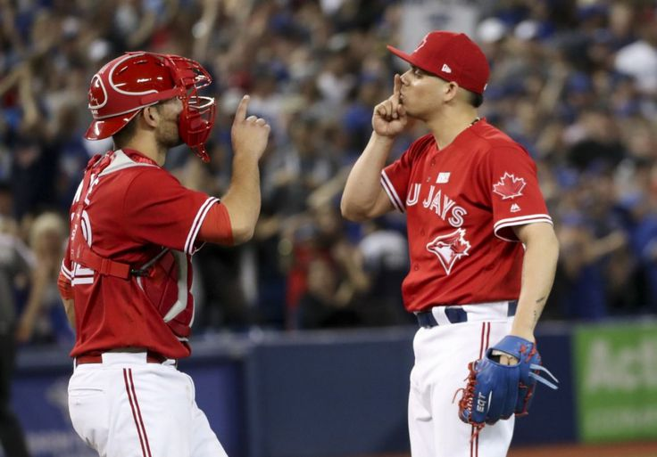 Catcher Luke Maile and closer Roberto Osuna celebrate in their own way after Osuna struck out the side to seal Sunday's Blue Jays victory over the Yankees at the Rogers Centre. June 4, 2017