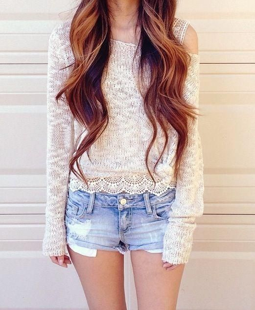 Casual summer wear, denim shorts and long brown waves with highlights.