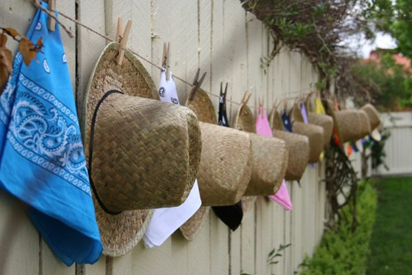 Hats hung along the fence...perfect as a decoration and party favors!
