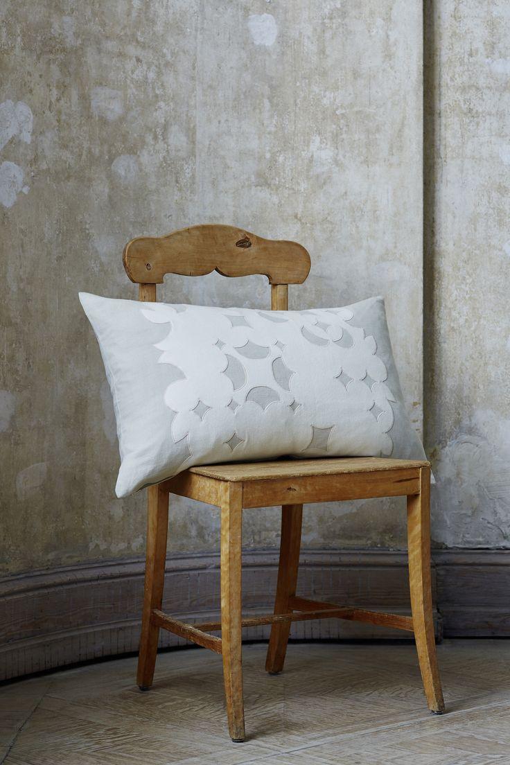 CUSHION MIRA by Création Baumann  The high quality application in wool on linen plays with ethnic and contemporary graphic elements. Colour differentiated accent embroidery enhances and underlines the value and quality of the cushion which derives from the use of pure wool and linen.