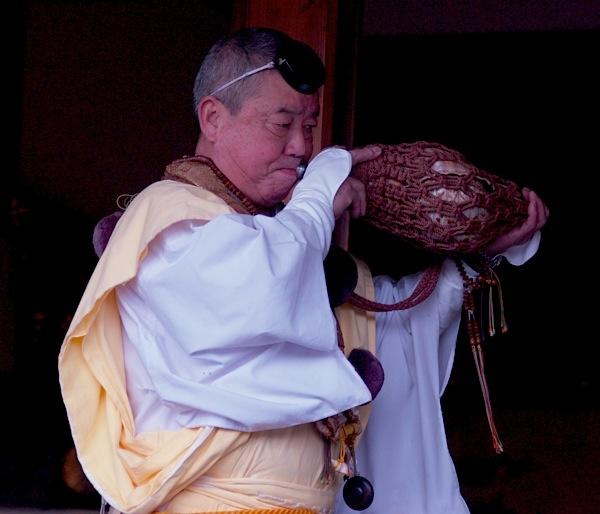 Yamabushi playing seashell horn