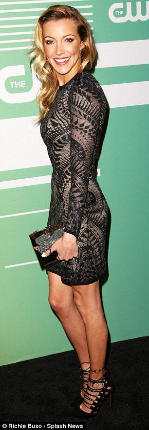 On target: Fellow Arrow star Katie Cassidy showed off her long and slender legs in a black...