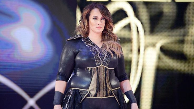 Nia Jax responds to fan upset because WWE announces her weight, Paige chimes in
