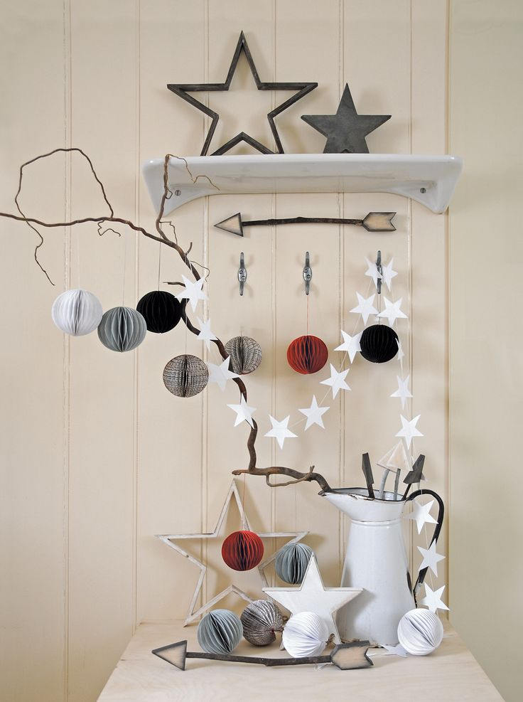 East of India baubles, garlands and star display. Lovely Christmas style