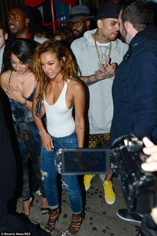 Karrueche- white tank bodysuit, boyfriend jeans,   heels ♡ it!