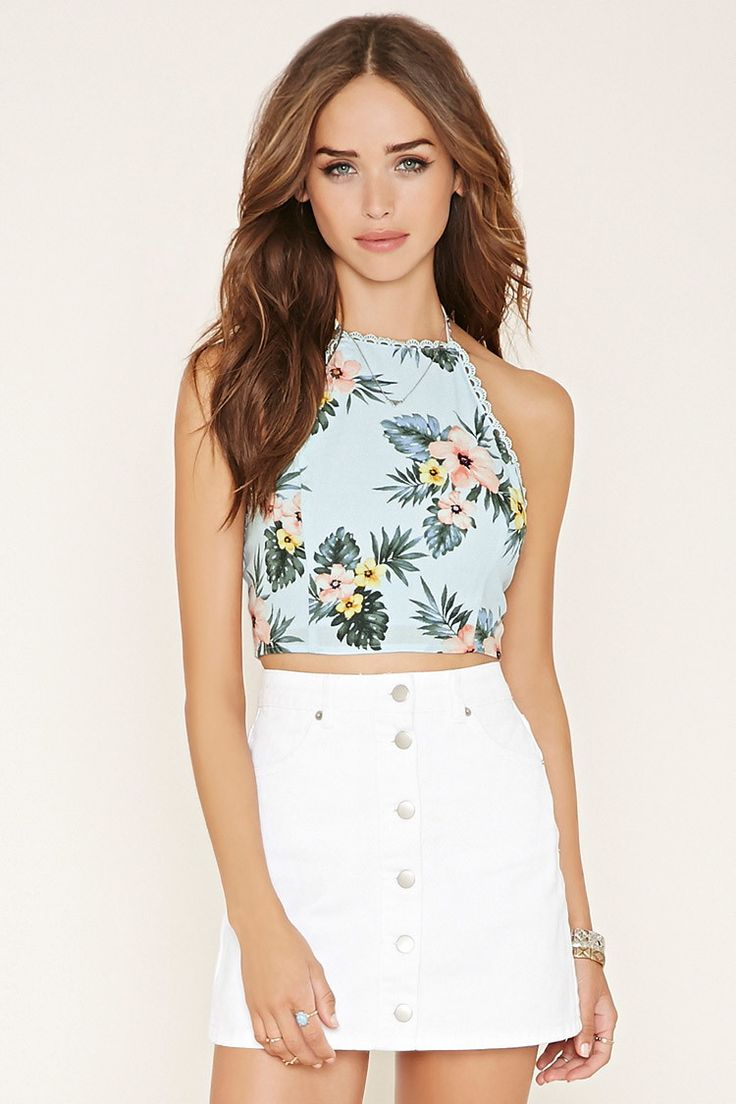 A floral print woven crop top with self-tie halter straps, scalloped crochet trim, an open back, and a two-button back closure.