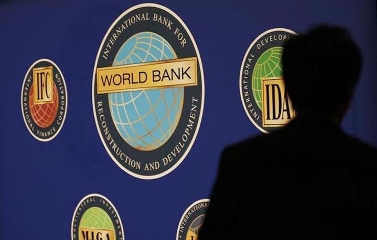 World Bank cuts Inga Dam money supply on social, environmental concerns.   A man is silhouetted against the logo of the World Bank at the main venue for the International Monetary Fund (IMF) and World Bank annual meeting in Tokyo October 10, 2012. REUTERS/Kim Kyung-Hoon