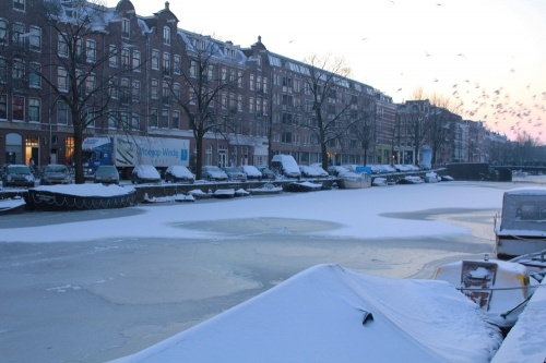 Amsterdam. iced over canals.   I can't wait to go!