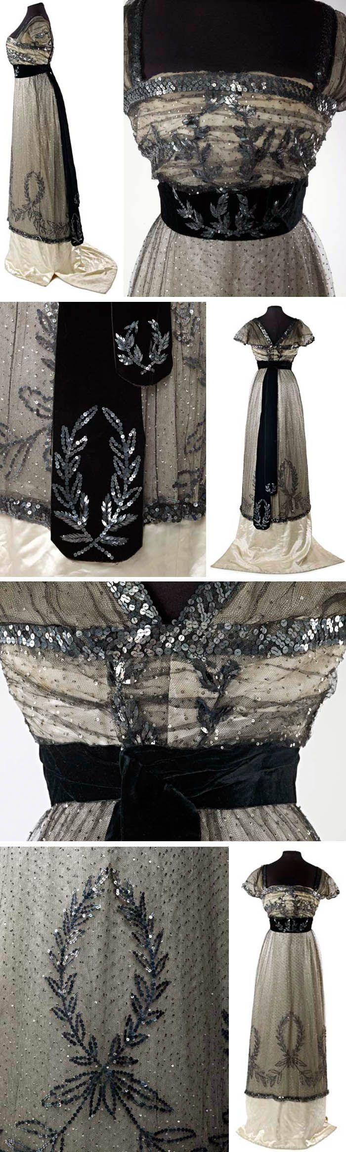 """Evening dress, Mme. Hayward, London, ca. 1909-10. Silk, metal, cotton. This skirt is part of a dress that is included in Janet Arnold's """"Patterns of Fashion: Englishwomen's dresses and their construction ca. 1860-1940."""" She describes it as """"an evening dress in black silk net covered with tiny 1/8"""" silver sequins over an ivory satin underskirt."""" Museum of London"""