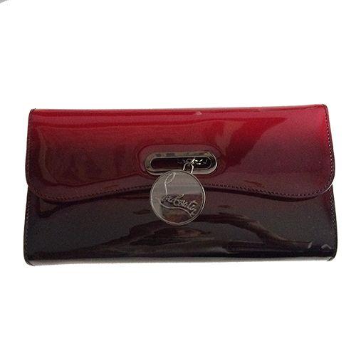 Este clutch en charol rojo y negro difumidado de #ChristianLouboutin es el bolso perfecto para una fiesta o boda de noche. ¿Con qué lo combinarías?: http://bit.ly/1Rkl8Lx