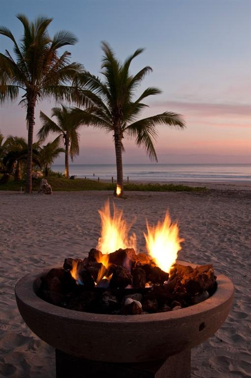 Fire pit at beach wedding. For kids and grandparents.