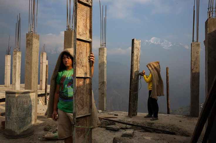 Villagers work communally to rebuild houses and a new religious stupa in the village of Barpak, in Gorkha district, Nepal  at the epicenter of the 2015 quakes, which destroyed most of the village, April 5, 2016.