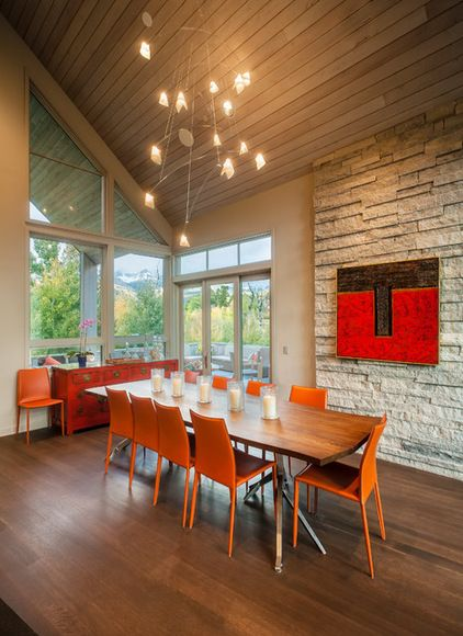 More cool orange dining chairs, this time in a dining room washed in warm neutrals. The warmth of the palette makes this a cozy and inviting space for a dinner party on even the coldest of Denver evenings