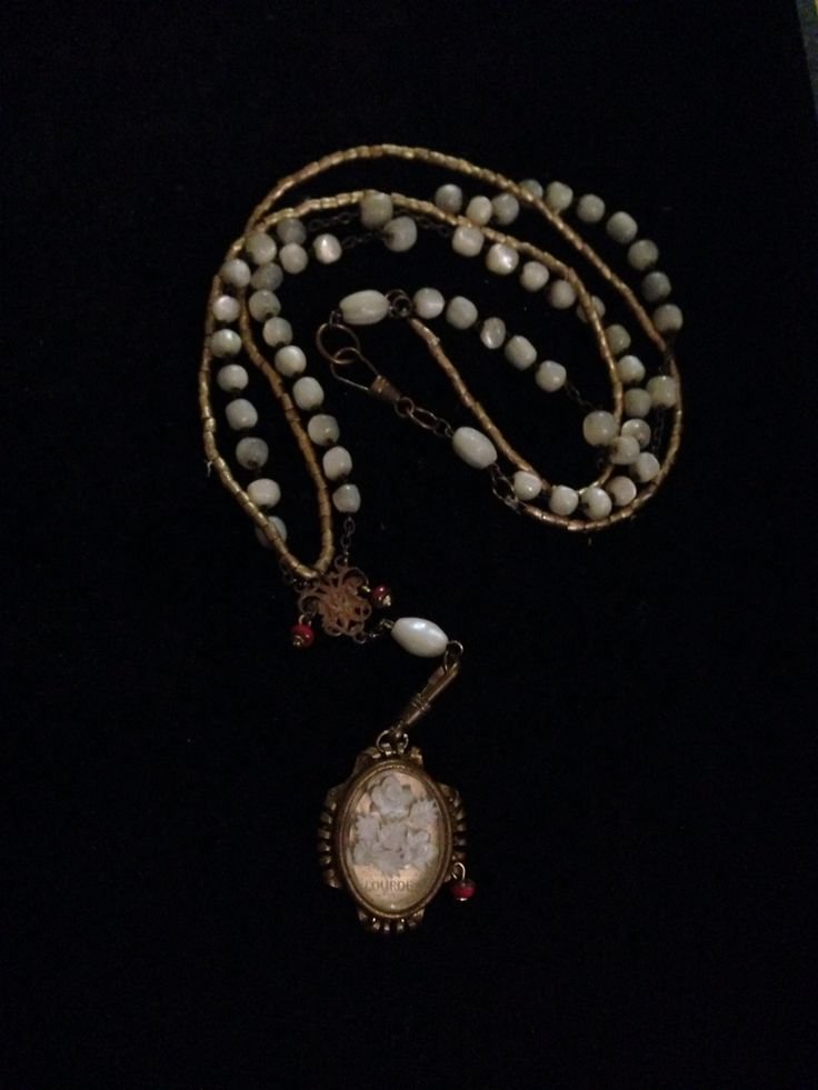 A little dream wit heishi beads antique mother of pearl rosary beads & an antique pendant with white flower inlay from Lourdes Available