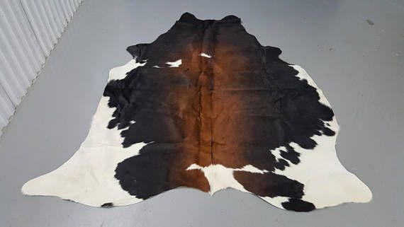 You Will Receive The Exact Cowhide Rug As Shown In The Image. Size is 69 by 60 inches. Exotic And Unique Mostly Dark Reddish Brown With White Edges. All our cowhide rugs are hand picked from Brazil and individually selected for its unique and exotic pattern. Each Cow Rug Is Hand finished and Chromium Tanned, making each hide very soft and smooth. Perfect to use it as a rug, wall hanging, couch throw or upholstery. I ship out the hide same day.