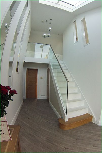 Karinya Staircase - a softwood white primed flight of stairs with an oak D-End feature step.