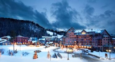 The Village at Winter Park Resort lights up as the sun sets on the ski day - Winter Park, CO #Silverleaf Resorts