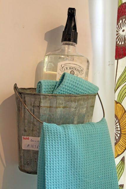 Itsy Bits and Pieces- Old Bucket Hung on a Wall for Towels, etc.  ... would be great for the outside shower