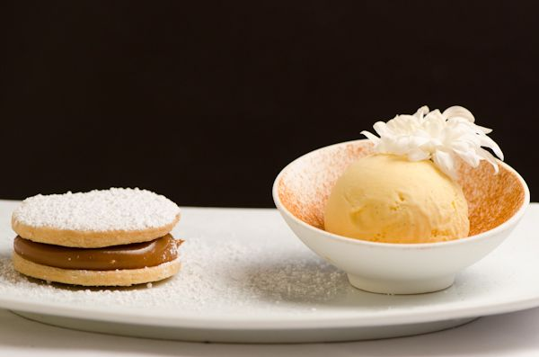Traditional Alfajor Cookies: Keylime-scented Shortbread Cookie filled with Peruvian Manjar Blanco Caramel, and Lucuma Ice Cream
