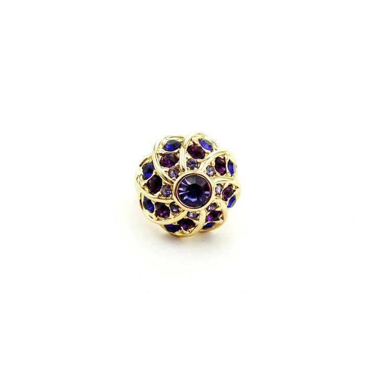 "Stefanie. Floral design of gold metal colour with purple rhinestones. Lightweight. Band width:0.5cm(.2"") - 1.5cm(.6""). Décor diameter: 2cm(.8"") ."