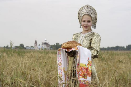 Russian Culture 101 in Photos: Russian Girl in Traditional Dress with Bread