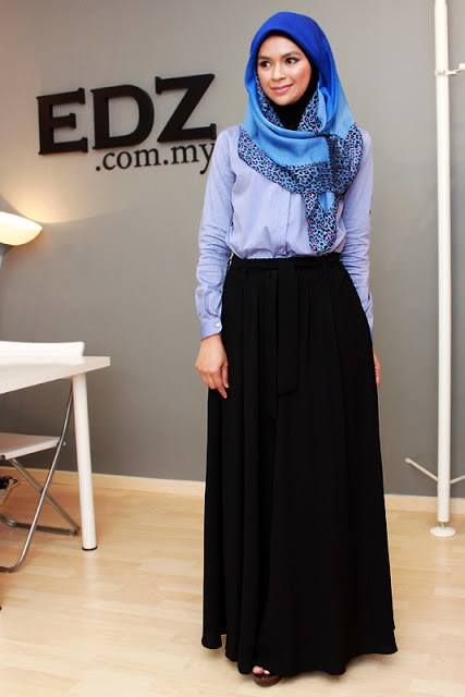 Black skirt, blue button up shirt, brown shoes, blue and black scarf