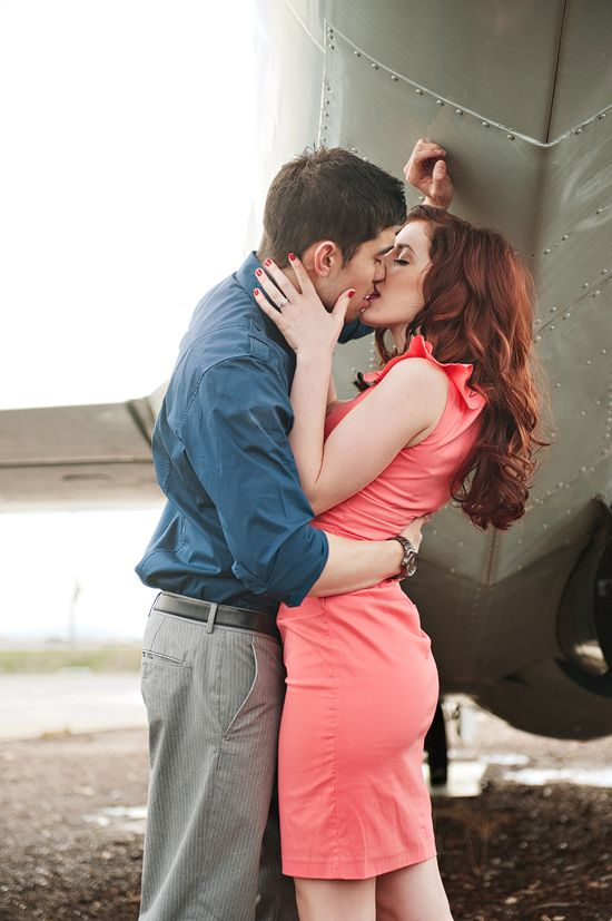 Airplane Engagement Shoot Kiss.. pretty, I love her hair color.