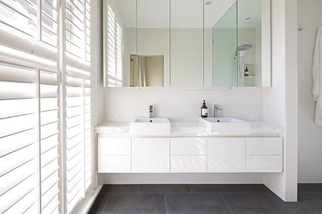 The white palette recurs throughout the new section of the house.