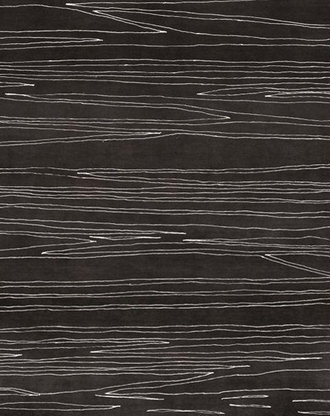 siyah beyaz ince çizgileri ile yapılmış modern halı