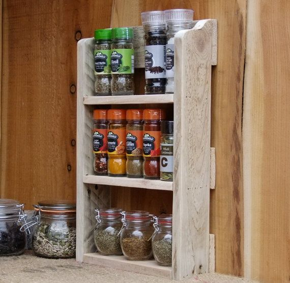 Handmade rustic spice rack made from reclaimed pallet wood available in 3 finishes.  Examples of the finishes: Dark oak - Picture 1 Medium oak - picture 2 Natural finish ( No stain or wax applied) - Pictures 3 &4  We pride ourselves on the build quality and finish of our items, please take a look at our reviews and buy with confidence.  The pallet wood we use is full of character with old nail marks and ware from its previous life. The shelf you will receive will have similar character bu...